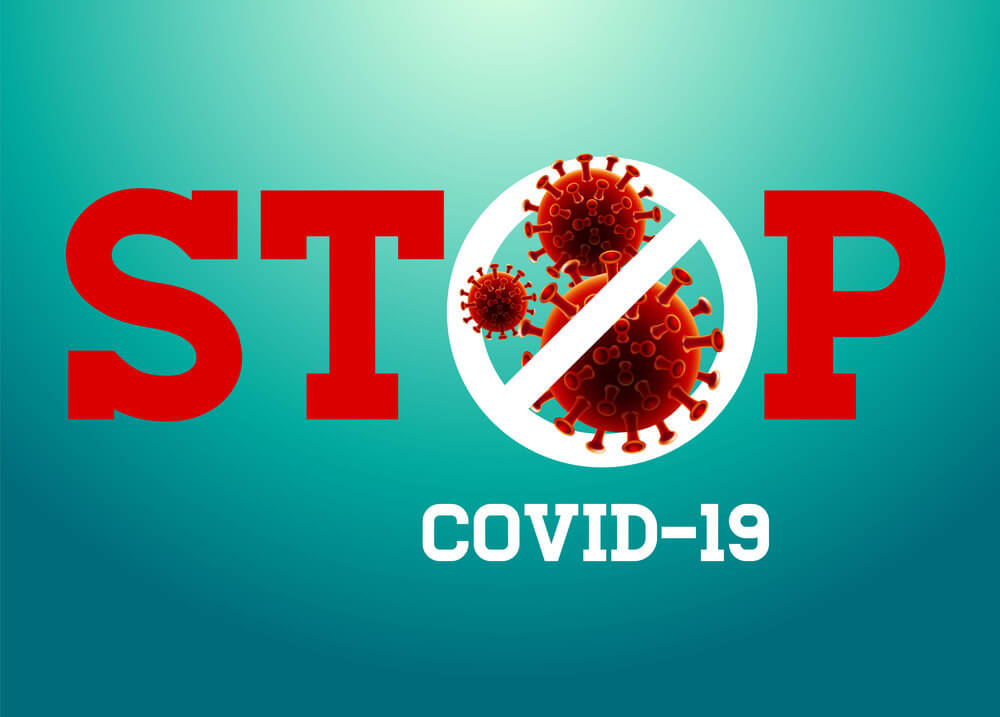 Stop sign with crossed out virus and covid-19 inscription