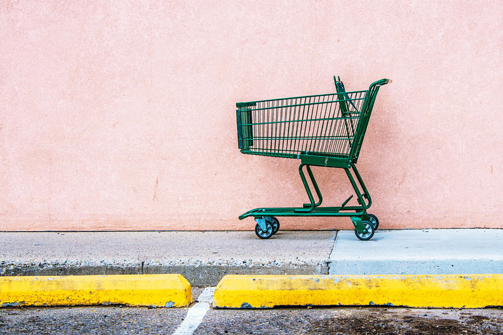 Shopping trolley behind a yellow curb