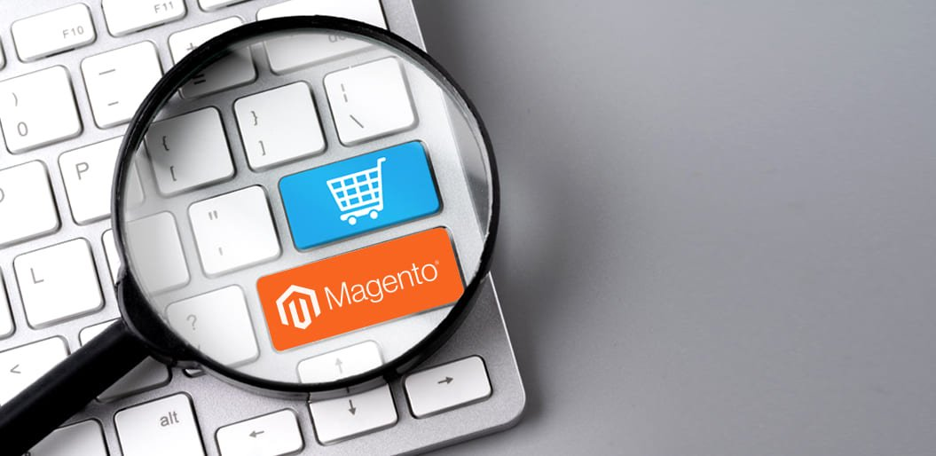 Magnifier magnifying the keys with a shopping cart and Magento