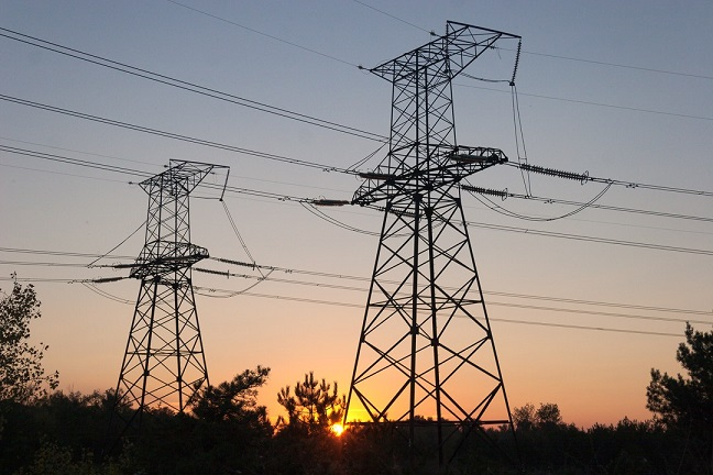 Power pylons and the setting sun