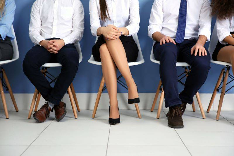 People sitting in the waiting room waiting for a job interview